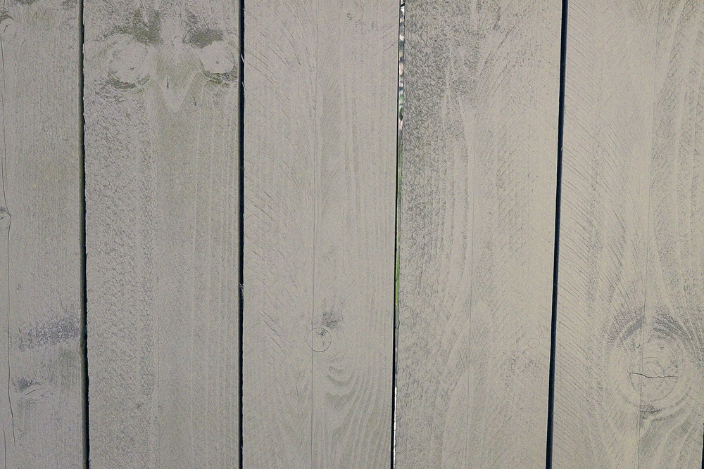 Light gray, washed out look on outdoor fence - Residential painting by Nash Painting Nashville TN