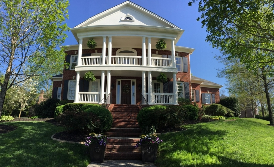 Exterior white paint on balcony, porch, roof - Residential painting by Nash Painting Nashville TN