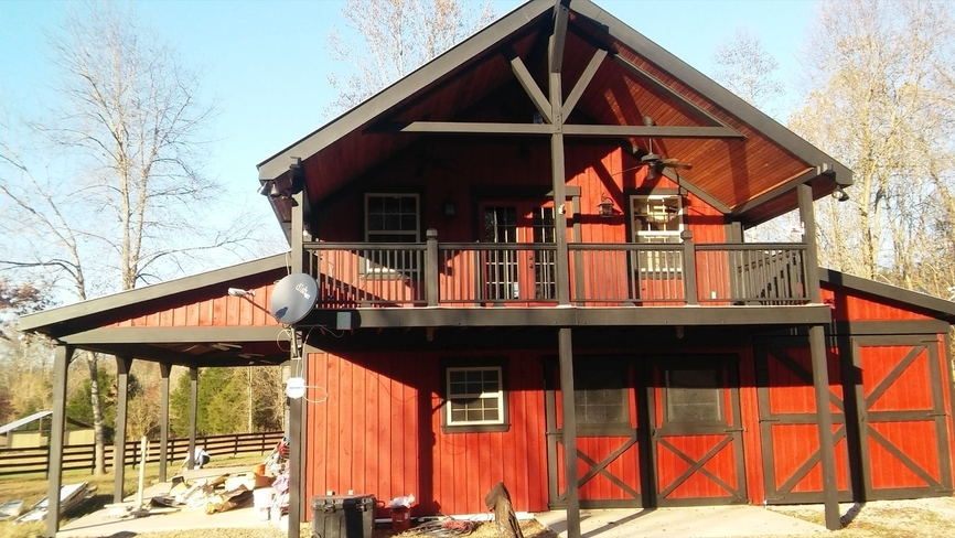Exterior red and black paint on barn-style home - Residential painting by Nash Painting Nashville TN