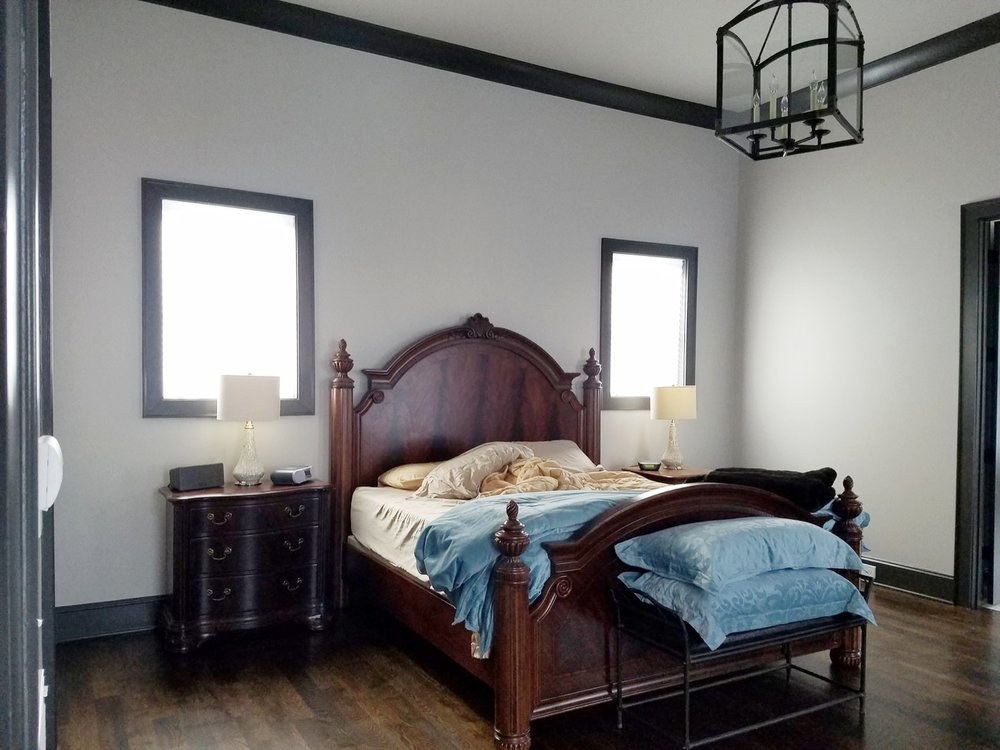 White bedroom with black trim - Residential painting by Nash Painting Nashville TN