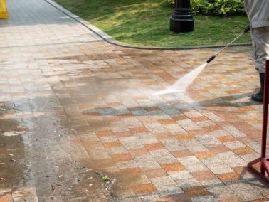 Nash Painting residential exterior power washing on bricks
