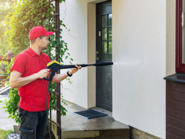 Nash Painting pressure washing a home's exterior