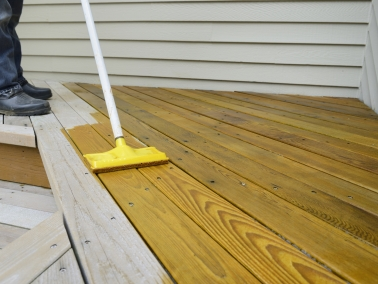 Someone staining a deck