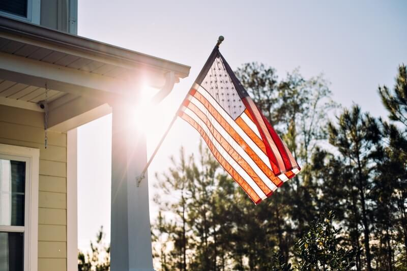 American flag hanging outside a house